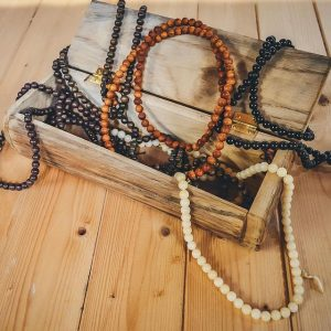 mala necklaces in wooden jewellery box