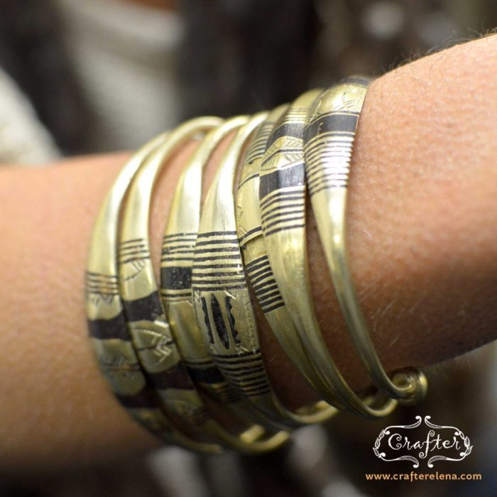 Brass tuareg bracelets multiple on hand