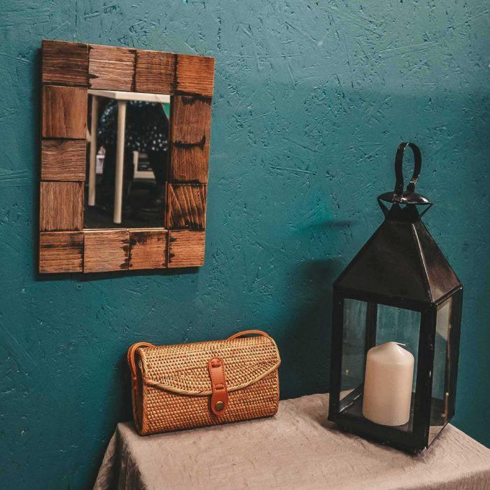 Oval Rattan Bali Bag Brown on table candle holder mirror boho decor