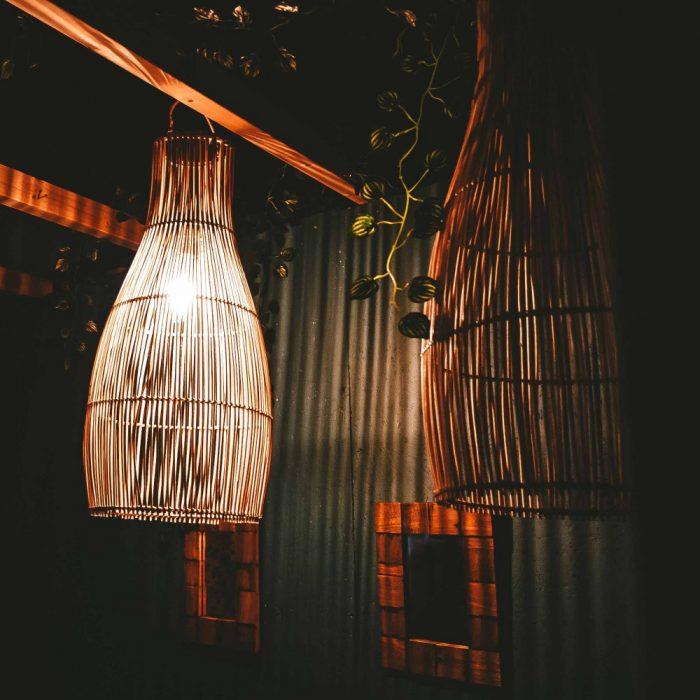 Rattan Lampshade Lantern with light in dark hanging garden