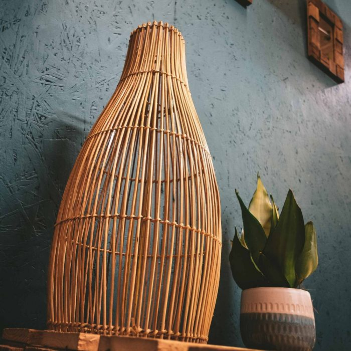 Rattan Lampshade Lantern on table with plant