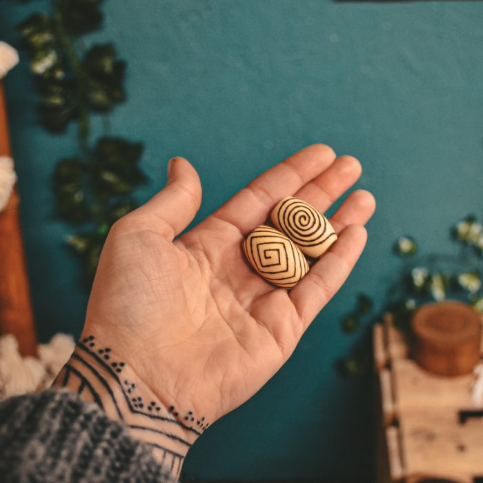 Spiral Mood Pyrography Wooden Dread Beads in tattooed hand